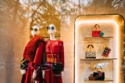 Female Mannequins And Fashion Accessories In Shop Window Showcase Of Store Mall Market.