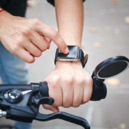 Smart watches are helping the cyclist on the street, hand in close-up